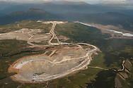 view north across Todagin Plateau and Red Chris pits, waste rock & low-grade rock dumps, and mill and process areas.  Transboundary Mines, 2017