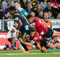 Highlanders' Waisake Naholo, left, is tackled by Crusaders' George Bridge and Codie Taylor in the Super Rugby match, Forsyth Barr Stadium, Dunedin, New Zealand, Saturday, March 17, 2018. Credit:SNPA / Adam Binns ** NO ARCHIVING**