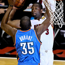 Jun 19, 2012; Miami, FL, USA; Miami Heat shooting guard Dwyane Wade (3) shoots over Oklahoma City Thunder small forward Kevin Durant (35) during the first quarter in game four in the 2012 NBA Finals at the American Airlines Arena. Mandatory Credit: Derick E. Hingle-US PRESSWIRE