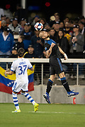 March 2, 2019; San Jose, CA, USA; San Jose Earthquakes defender Guram Kashia (37) heads the ball against Montreal Impact forward Maximiliano Urruti (37) during the second half at Avaya Stadium.