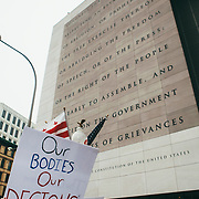 Protestors march past the Newseum building with the First Amendment to the Constitution in the Women's March on Washington D.C., January 21, 2017