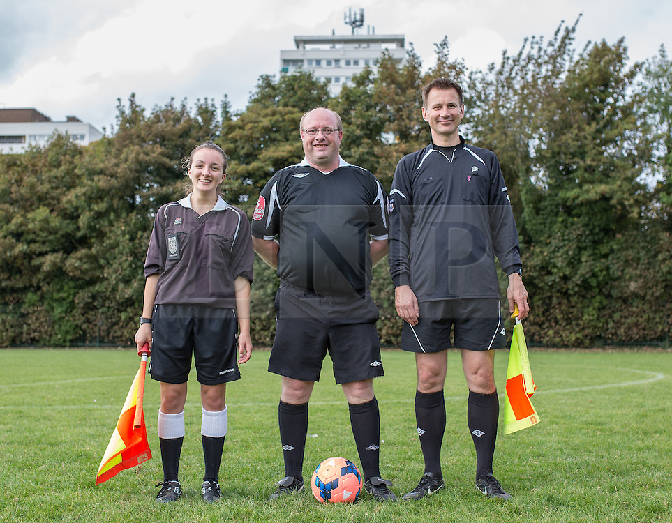 © Licensed to London News Pictures . 28/09/2014 . Birmingham , UK . Officials L-R Linesman Paloma Vince , Referee Chris Banks and Linesman Health Secretary Jeremy Hunt . Conservative Party vs Journalists football match at a Birmingham University football pitch , at the start of the conference . The 2014 Conservative Party Conference in Birmingham . Photo credit : Joel Goodman/LNP