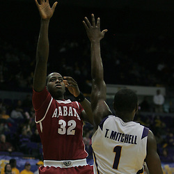 Jan 09, 2010; Baton Rouge, LA, USA; Alabama Crimson Tide forward JaMychal Green (32) shoots over LSU Tigers forward Tasmin Mitchell (1) during the second half at the Pete Maravich Assembly Center. Alabama defeated LSU 66-49.  Mandatory Credit: Derick E. Hingle-US PRESSWIRE