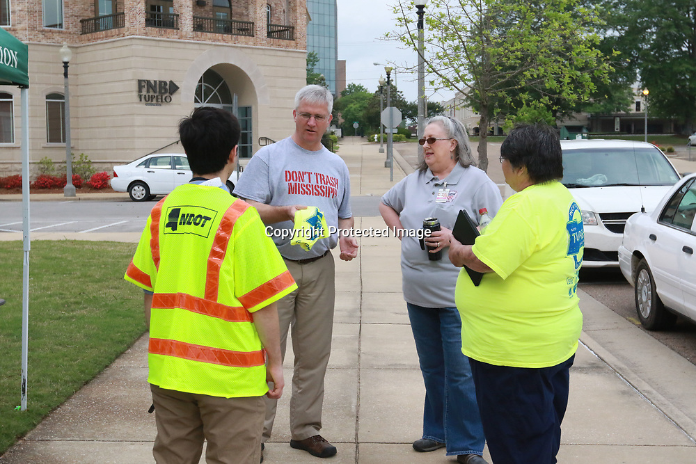 LIBBY EZELL | BUY AT PHOTOS.DJOURNAL.COM<br /> Transportation Comissioner Mike Tagert, back left, discusses locations with volunteers Saturday for &quot;Pick it Up, Tupelo!&quot;