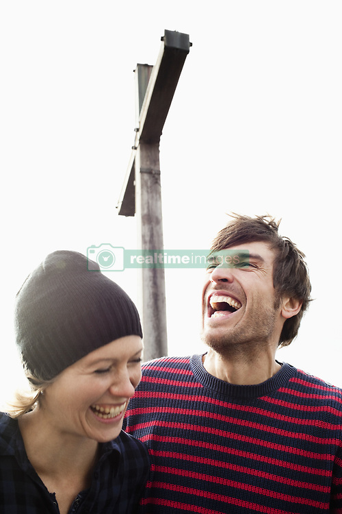 Sep. 05, 2010 - Couple laughing under mountain cross. Model Released (MR) (Credit Image: © Cultura/ZUMAPRESS.com)
