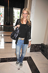 POPPY DELEVINGNE at a party to celebrate the relaunch of the Langham Hotel, Portland Place, London on June 10th 2009.