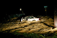 4/16/2011 A car washed off the road by flooding on Old National Pike outside of Middletown, M