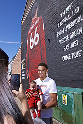 LIVERPOOL, ENGLAND - Thursday, August 8, 2019: Trent Alexander-Arnold poses for photographs with supporters at the official opening of a mural of Liverpool's Trent Alexander-Arnold on the side of a building in Sybil Road, Anfield. The mural was commissioned by The Anfield Wrap and painted by local artist Akse P19. (Pic by David Rawcliffe/Propaganda)