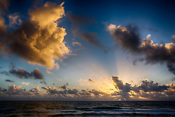 spectacular sunrise through the clouds over The Atlantic Ocean in Fort Lauderdale, Florida