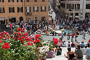 "Shoppers and tourists mingle on the Spanish Steps in Rome, Italy. The steps, known as ""The Scalinata"" in Italian, are the longest and widest staircase in Europe."