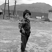 Roma camp in the outskirt of Mitrovice, Kosovo. The camp lies in the vicinity of the rubbish dumps of the area and in between the Serbian and the Kosovan part of the city.  Both sides do not want the Roma gypsies.