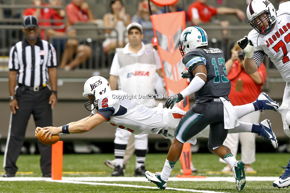 Sep 7, 2013; New Orleans, LA, USA; South Alabama Jaguars quarterback Ross Metheny (2) dives in for a touchdown against the Tulane Green Wave during the second quarter of a game at the Mercedes-Benz Superdome. Mandatory Credit: Derick E. Hingle-USA TODAY Sports