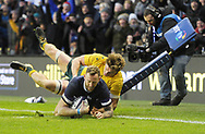 No Sales, Syndication or Archive <br /> <br /> Autumn Tests<br /> Scotland v Australia Saturday 25th November 2017, BT Murrayfield, Edinburgh.<br /> <br /> Byron McGuigan of Scotland scores despite Michael Hooper of Australia<br /> <br /> <br />  Neil Hanna Photography<br /> www.neilhannaphotography.co.uk<br /> 07702 246823