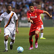 Emre Can, (right), Liverpool, is challenges Seydou Keita, AS Roma, in action during the Liverpool Vs AS Roma friendly pre season football match at Fenway Park, Boston. USA. 23rd July 2014. Photo Tim Clayton