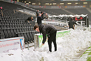 MK Dons fans and staff clearing the snow before the EFL Sky Bet League 1 match between Milton Keynes Dons and Bristol Rovers at stadium:mk, Milton Keynes, England on 3 March 2018. Picture by Nigel Cole.