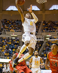 West Virginia Mountaineers guard Jevon Carter (2) shoots a layup after a steal against the Texas Tech Red Raiders during the first half at the WVU Coliseum.