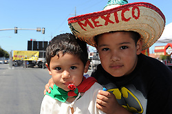 "Eduardo Salazar, 7, and his brother Josue, 2, at Sunday's ""El Grito,"" or ""The Cry of Independence"" celebrations in Salinas."