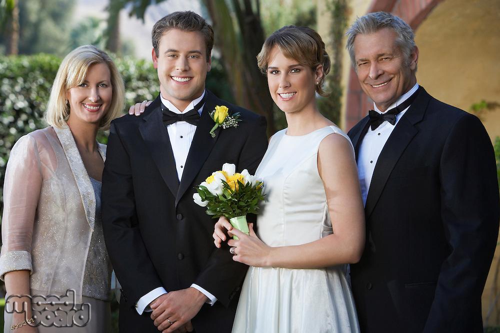 Bride, groom, and parents, portrait