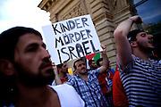 Mainz | 18 July 2014<br /> <br /> Am Samstag (18.07.2014) nahmen etwa 1000 M&auml;nner, Frauen und Kinder in der Innenstadt von Mainz anl&auml;sslich der milit&auml;rischen Auseinandersetzung zwischen Israel und der Hamas in Gaza an einer Solidarit&auml;tsdemonstration f&uuml;r Gaza, ein freies Pal&auml;stina und gegen Israel teil. Bei der Demo wurden Fahnen der Hamas und der Hisbollah mitgef&uuml;hrt, neben den &uuml;blichen Parolen gegen Israel wurde in Sprechch&ouml;hren auch vereinzelt zur Vernichtung von J&uuml;dinnen und Juden aufgerufen.<br /> Hier: Transparent &quot;Kinderm&ouml;rder Israel&quot;.<br /> <br /> <br /> &copy;peter-juelich.com<br /> <br /> [No Model Release | No Property Release]