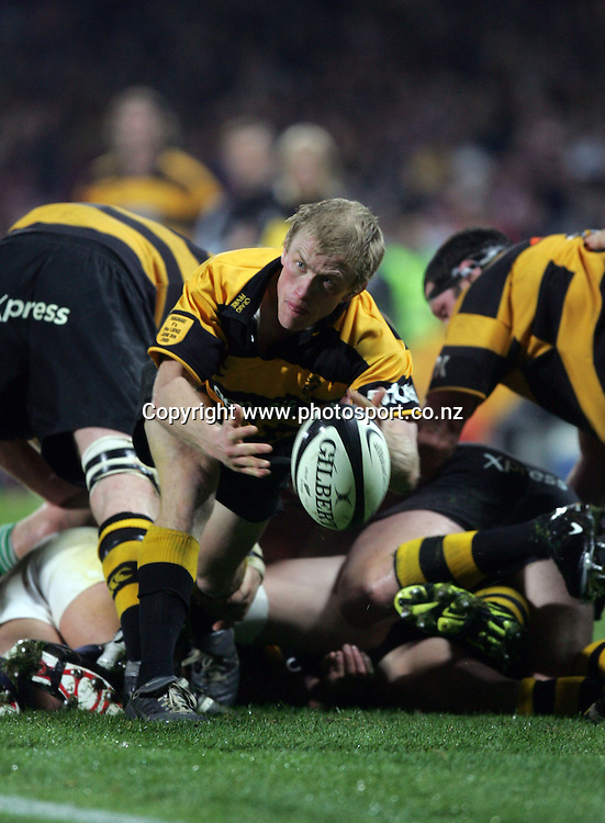 Craig Fevre passes out during the British and Irish Lions v Taranaki rugby match at Yarrow Stadium, New Plymouth, New Zealand on Wednesday 8 June, 2005. The Lions won the match, 36 - 14. Photo: Hannah Johnston/PHOTOSPORT