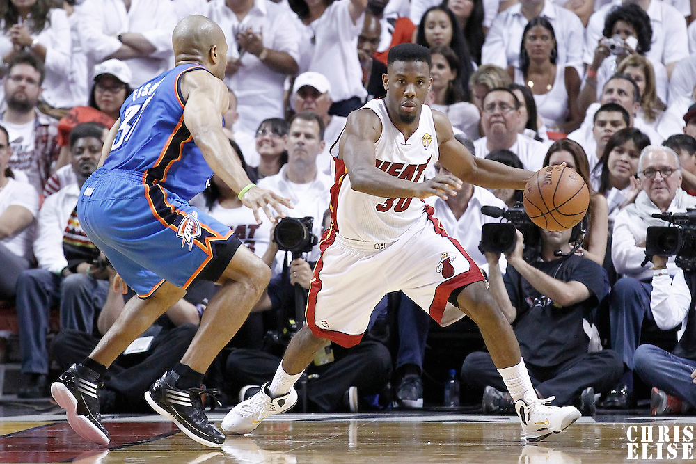 21 June 2012: Miami Heat point guard Norris Cole (30) brings the ball upcourt as Oklahoma City Thunder point guard Derek Fisher (37) defends on him during the Miami Heat 121-106 victory over the Oklahoma City Thunder, in Game 5 of the 2012 NBA Finals, at the AmericanAirlinesArena, Miami, Florida, USA. The Miami Heat wins the series 4-1.