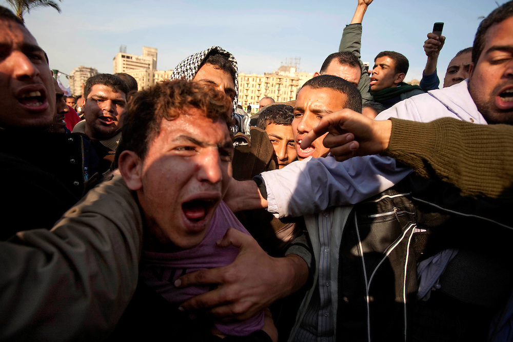 Anti-Mubarak protestors attempt to save a captured Mubarak supporter from lynching after a group of Mubarak supporters, some riding camels and horses, attempted to kill a group of anti-Mubarak protestors in Cairo, Egypt on Wednesday, Feb. 2, 2011.