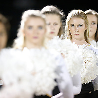 Thomas Wells | Buy at PHOTOS.DJOURNAL.COM<br /> Amory cheerleader Karli Knox, 17, and the rest of the squad listen to the National Anthem before their playoff game with New Albany Friday night.
