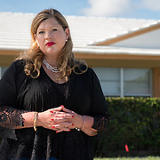 JUNE 25, 2017--DELRAY BEACH, FLORIDA<br /> Samantha Herring stands in front of a halfway house in Delray Beach where her cousin, ​Peter San Angelo, 28, was living prior to his death from an opioid drug overdose on October of 2016. San Angelo was found dead inside a van in a house's driveway not far from here.  Herring is investigating his death. <br /> (Photo by Angel Valentin/Freelance)