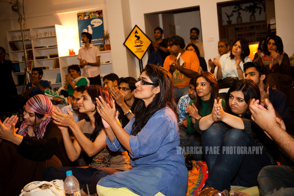 Pakistani audience members applaud during the performance of a interpretive dance show at T2F cafe on 5 March, 2011, in Karachi, Pakistan. The cafe/NGO caters to a growing number of liberal Pakistani youth in Karachi, providing a range of artistic and cultural services in their cafe/studio, which is adorned with photos of Pakistani and international artists, and local art work. (Photo by Warrick Page)