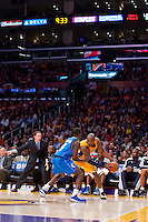 30 October 2012: Guard (24) Kobe Bryant of the Los Angeles Lakers looks to drive while being guarded by (4) Darren Collison of the Dallas Mavericks during the second half of the Mavericks 99-91 victory over the Lakers at the STAPLES Center in Los Angeles, CA.