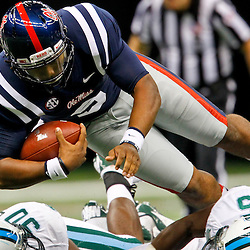 September 22, 2012; New Orleans, LA, USA; Ole Miss Rebels quarterback Maikhail Miller (9) trips over Tulane Green Wave safety Brandon LeBeau (5) during the second half of a game at the Mercedes-Benz Superdome. Ole Miss defeated Tulane 39-0. Mandatory Credit: Derick E. Hingle-US PRESSWIRE