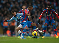 Bernardo Silva of Manchester City (L) and Jordan Ayew of Crystal Palace in action - Mandatory by-line: Jack Phillips/JMP - 18/01/2020 - FOOTBALL - Etihad Stadium - Manchester, England - Manchester City v Crystal Palace - English Premier League