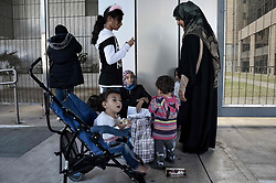 October 8, 2018 - Athens, Greece - Women and children seen staying outside of the Ministry of Migration Policy during the protest of refugees about the conditions of the refugee camps. (Credit Image: © Giorgos Zachos/SOPA Images via ZUMA Wire)