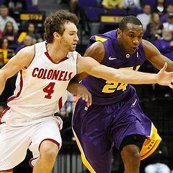 November 12, 2011; Baton Rouge, LA; Nicholls State Colonels guard Ben Martin (4) chases after a loose ball with LSU Tigers forward Storm Warren (24) during the first half of a game at the Pete Maravich Assembly Center.  Mandatory Credit: Derick E. Hingle-US PRESSWIRE