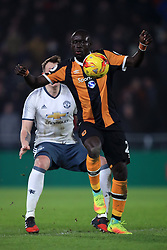 Manchester United's Phil Jones (left) and Hull City's Oumar Niasse battle for the ball