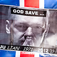 LONDON, UK - 30th May 2012: Julian Assange picture on a banner reading 'God Save... Ju Lian 1971-2012 ??' outside the Supreme Court in central London, minutes after Assange's loss of his extradition appeal.