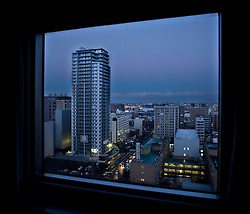 Japan.Sapporo. Buildings through the window at night ©Carmen Secanella.