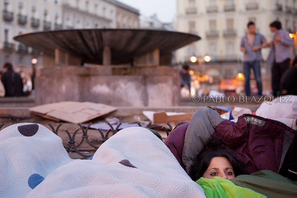 Protesters sleep at Puerta del Sol square Camp in Madrid in the early hours on May 21, after all-night festivities in defiance of a 48-hour ban ahead of local elections. Some 25,000 people, according to Spanish media, crammed the central Puerta del Sol square and surrounding streets late on May 20, 2011 to stage a silent protest and then erupted in whistles and cheers of joy as the ban, ordered by Spain's election commission, took effect at midnight.