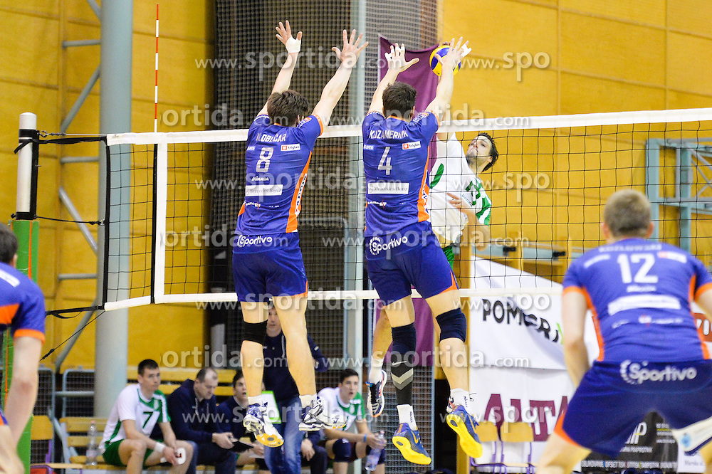 Aljosa Bogazalec of Panvita Pomgrad vs Jan Kolubcar, Jan Kozamernik  of ACH during volleyball game between OK Panvita Pomgrad and ACH Volley in 2nd semifinal match of  Slovenian National Championship 2015, on April 5, 2015 in Murska Sobota, Slovenia. Photo by Mario Horvat / Sportida