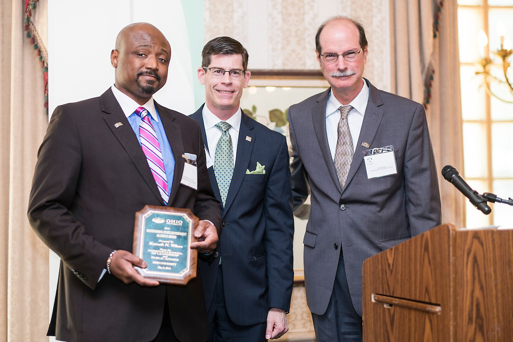 Kenneth N. Wilson, left, Michael Adelman and Mark Weinberg pose for a photo with Wilson's Outstanding State Government Alumnus Award during the Ohio University State Government Alumni Luncheon on Tuesday, May 5, 2015.  Photo by Ohio University  /  Rob Hardin
