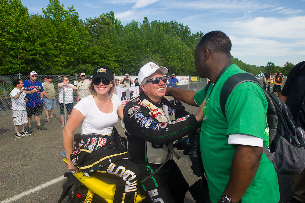 ENGLISHTOWN, NJ - MAY 31:  NHRA funny car driver John Force and NHRA top fuel dragster driver Brittany Force at Raceway Park on May 31, 2013 in Englishtown, New Jersey. (Photo by Rob Tringali) *** Local Caption *** John Force;Brittany Force