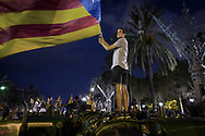 Pro-independence supporters stand in perplexity after Catalan President Carles Puigdemont announced the independence of Catalonia and suspended it right after to allow negociations with the Spanish government. October 10, 2017 in Barcelona, Spain.