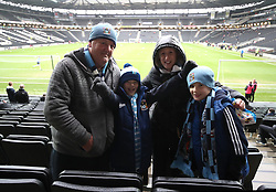 Coventry City fans Joshua, Callum, Gayle and Neil Grant  await the kick off at  Stadium MK for their teams FA Cup Fourth Round match against MK Dons