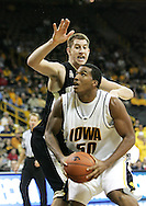 26 NOVEMBER 2007: Iowa forward Jarryd Cole (50) tries to get an open shot at the basket around Wake Forest center Chas McFarland (13) in Wake Forest's 56-47 win over Iowa at Carver-Hawkeye Arena in Iowa City, Iowa on November 26, 2007.