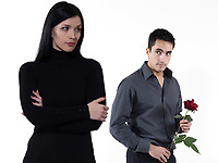 amn offering a rose to a woman