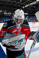KELOWNA, BC - NOVEMBER 8: Roman Basran #30 of the Kelowna Rockets stands at the boards during warm up against the Medicine Hat Tigers  at Prospera Place on November 8, 2019 in Kelowna, Canada. (Photo by Marissa Baecker/Shoot the Breeze)