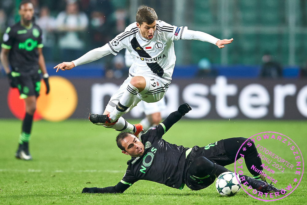 Warsaw, Poland - 2016 December 07: (L) Bartosz Bereszynski of Legia Warsaw fights for the ball with (R) Bruno Cesar of Sporting CP during soccer match Legia Warszawa v Sporting Clube de Portugal - UEFA Champions League  Group F at Municipal Stadium on December 07, 2016 in Warsaw, Poland.<br /> <br /> Adam Nurkiewicz declares that he has no rights to the image of people at the photographs of his authorship.<br /> <br /> Picture also available in RAW (NEF) or TIFF format on special request.<br /> <br /> Any editorial, commercial or promotional use requires written permission from the author of image.<br /> <br /> Mandatory credit:<br /> Photo by &copy; Adam Nurkiewicz / Mediasport