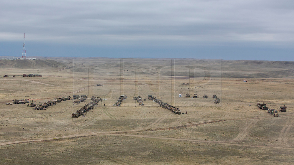 © Licensed to London News Pictures. 08/10/2014.  British Army Training Unit Suffield (BATUS), Canada. As the exercise known as Prairie Storm 3 comes to an end the vehicles form up ready to make their way back to the main base in Canada.<br />   <br /> BATUS has been home to the Army for the past 42 years.  It is the only place where all elements of the British Army train together for war.  The soldiers are put to test on everything from armoured vehicles to infantry tactics.        Photo credit : Alison Baskerville/LNP