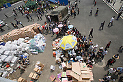 Aid is distributed to earthquake refugees at a camp in the sports stadium in Mianyang, China