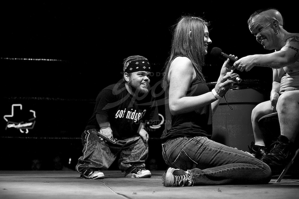 "The Half Pint Brawlers are an eccentric group of self-proclaimed ""Bloody Midgets"", who travel the world entertaining crowds with their bizarre stage performances...This essay, photographed in January of 2009 features Half Pint Brawlers founder ""Puppet the Psycho Dwarf"" and wrestler, ""Little Kato""."